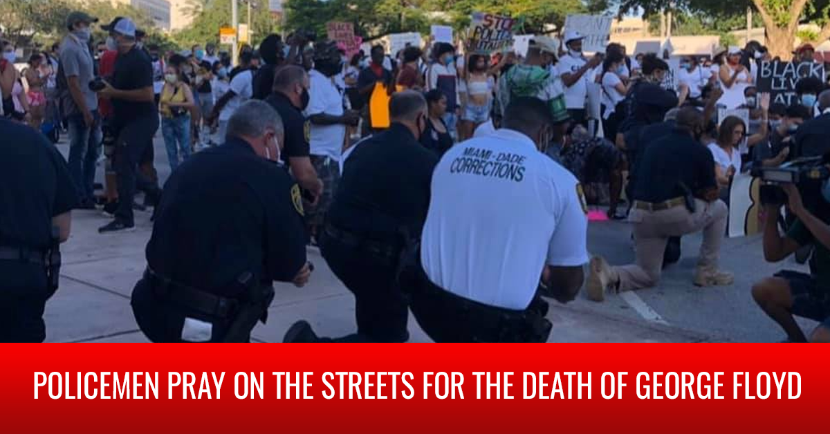 Policemen pray on the streets for the death of George Floyd